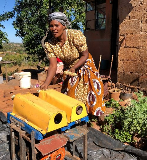 Clara Chikuni has gained a reliable income since becoming a mechanization service provider and offering maize shelling in her local area. Photo: CIMMYT/Matthew O'Leary