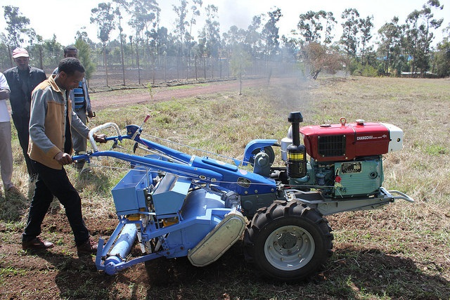 Bedilu Desta , an agricultural mechanization service provider demonstrates a two wheel tractor. Photo: CIMMYT/Frédéric Baudron