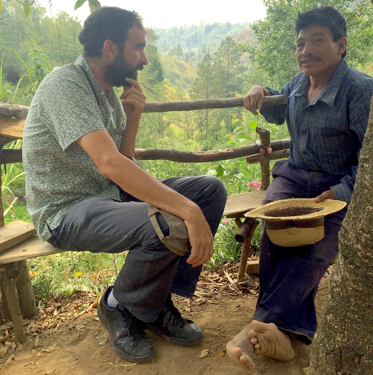 Senior scientist Santiago Lopez-Ridaura (left) asks a farmer in Guatemala about his priorities — produce food, generate income, maintain soil health and feed his livestock — and the reasons behind his agricultural practices. (Photo: Carlos Sum/Buena Milpa)