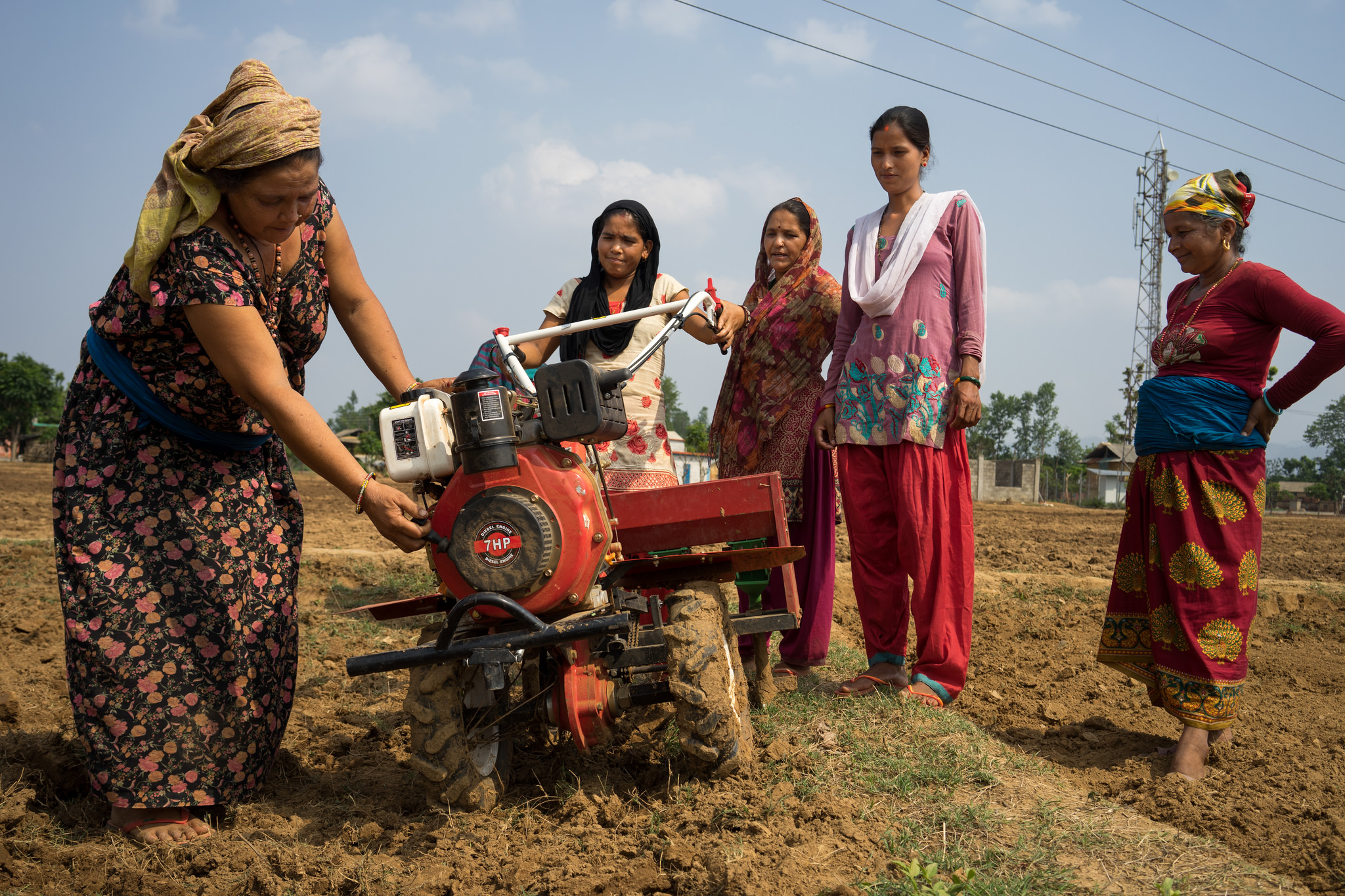 Women farmers in Nepal use a mini tiller for direct seeding. (Photo: P.Lowe/CIMMYT)