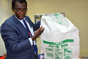 The director of the Africa Technical Research Centre explains how hermetic bags help control pests and aflatoxins. (Photo: Joshua Masinde/CIMMYT)