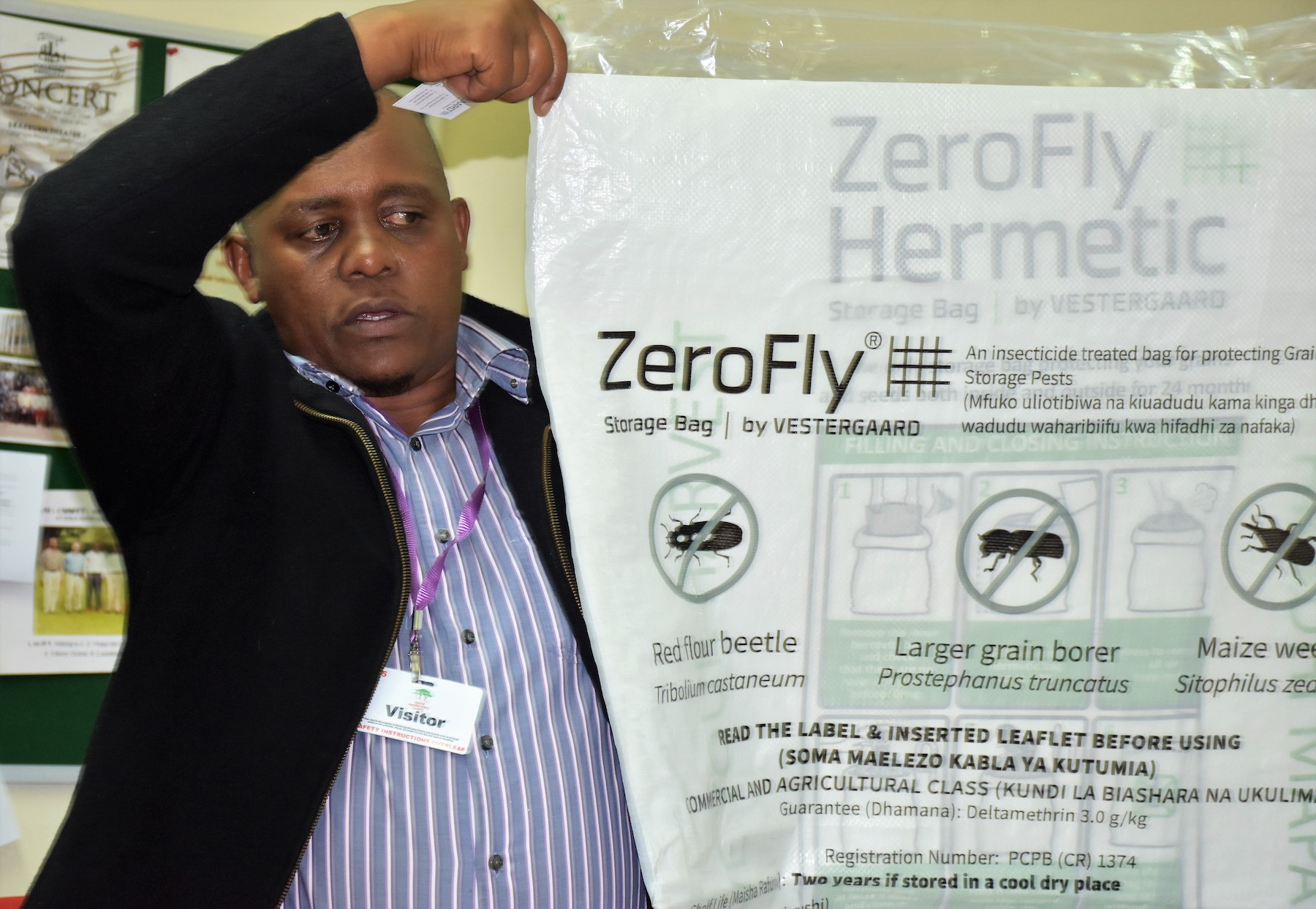 Vestergaard's East Africa Area Manager, James Ndiritu, shows their model of hermetic bag. (Photo: Joshua Masinde/CIMMYT)